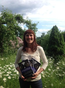 Margunn Bjørnholt with her co-edited book, Counting on Marilyn Waring: New Advances in Feminist Economics.