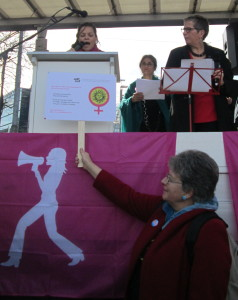 """""""ADF-SVF suisse addressing the audience: Charlotte Mosquera reading the statement and Martine Gagnebin, president of ADF-SVF suisse, holding up our logo"""""""